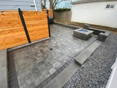 Few more details and our Port Washington, NY patio is a wrap, enjoy! #stonecreationsoflongisland #masonry #pavers #patios #pools #firefeatures #cedarfencing #cambridgepavers #ledgestone #nassaucounty #portwashington #longisland #newyork #experiencematters @ Port Washington, New York
